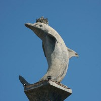 A stone statue of a dolphin in Bali.