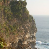 In Bali cliffs emerge high above the sea.