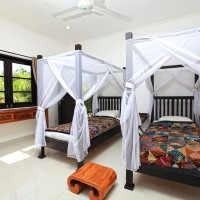 The vacation villa in Bali also has a bedroom with two single beds.