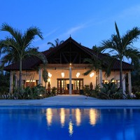 Bima Sena villa with pool in Bali at nightfall.