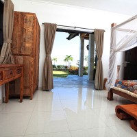From the bedroom you can walk on the terrace of the villa in Bali.