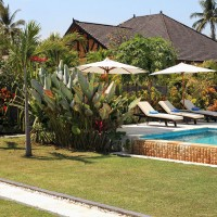 Relax at the pool surrounded by a beautiful garden in our holiday in Bali.