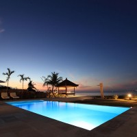 The illuminated pool of our holiday in Bali looks beautiful at night.