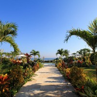 You can walk to the sea over the path through the well-tended garden of the holiday in Bali.