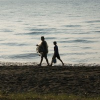 Balinese fisherman along the beach.