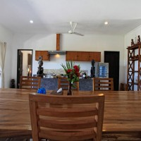 The dining area with open kitchen.