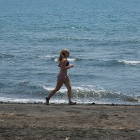 You can run along the beach of Bali and enjoy beautiful surroundings all at once.