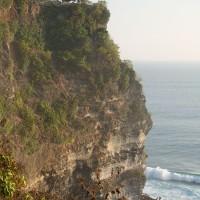 In Bali cliffs emerge high above the sea.