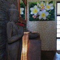 Buddha statue in the bathroom of the holiday villa in Bali.