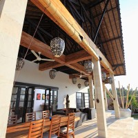 The fans provide cooling on the terrace of the villa in Bali.