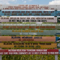 Beautiful picture with the rules that apply in Bali on colored planks.