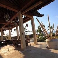 The villa has a terrace overlooking the Bali sea.