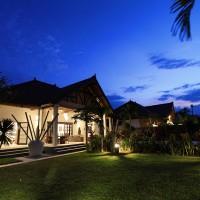 Holiday Villa Bima Sena in Bali at night.