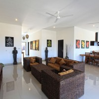 The villa has a spacious living and dining area.