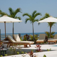 Relax in the luxurious lounge chairs located along the pool of our holiday in Bali.