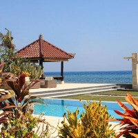 Swimming pool at holiday villa in Bali with lounge area.