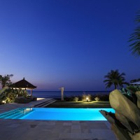 The pool of our holiday villa in Bali is lit up at night.